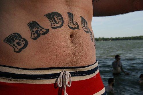Stomach tattoo, bad luck, designed inscription