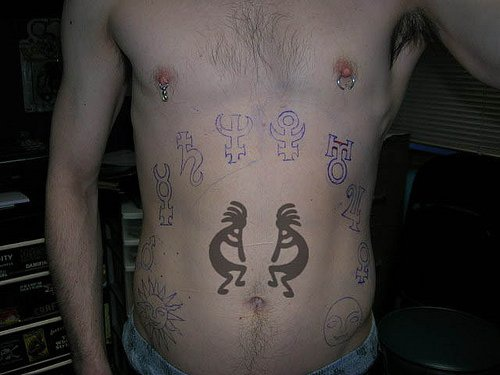 Stomach tattoo, african playing men, different signs, hieroglyphs