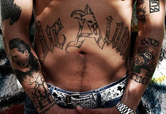 Stomach tattoo, very big, designed letters of two words