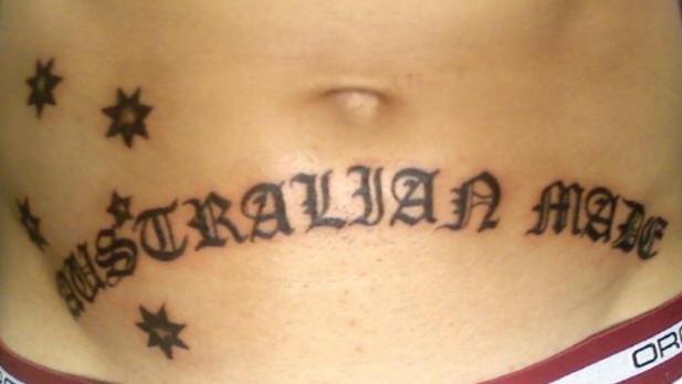 Stomach tattoo, australian made, styled inscription, stars