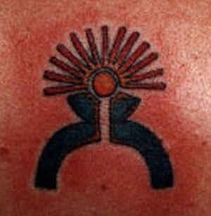 Astrologic sun symbol tattoo