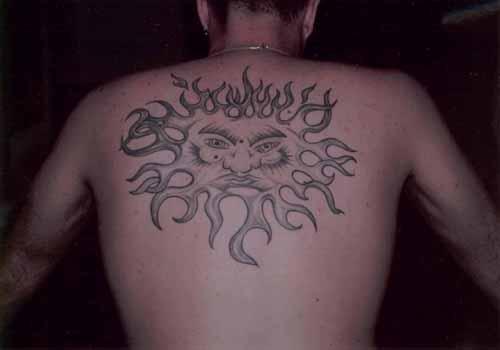 Large black sun tattoo on back