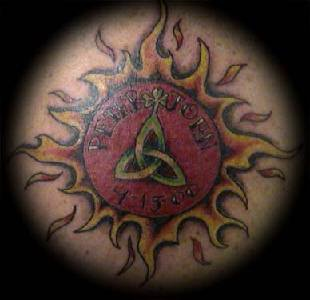 Sun and trinity symbol tattoo