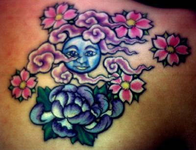 Full moon with flowers tattoo