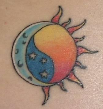 Coloured moon and sun tattoo
