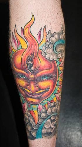 Humanized colourful sun tattoo