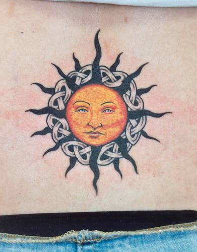Sun with knotted tracery tattoo