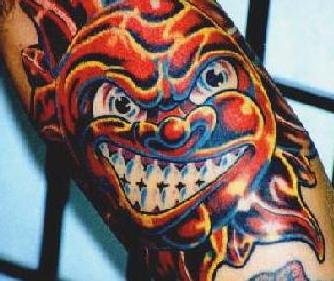 Angry coloured sun tattoo