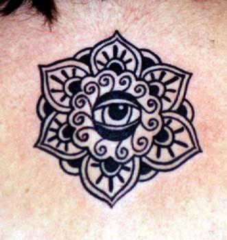 Eye in flower symbol tattoo