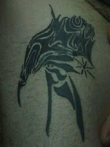 Tribal black ink artwork tattoo