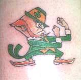 Green fighting leprechaun tattoo