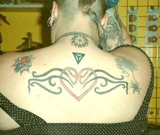 Heart with tribal tracery tattoo