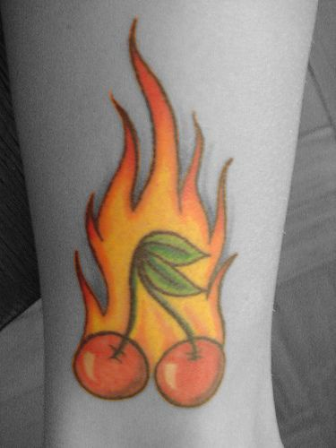 Flaming cherry tattoo in colour