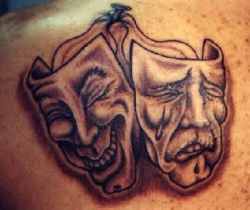 Theatrical masks black ink tattoo