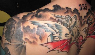 Monster and horse on upper back symmetrical tattoo