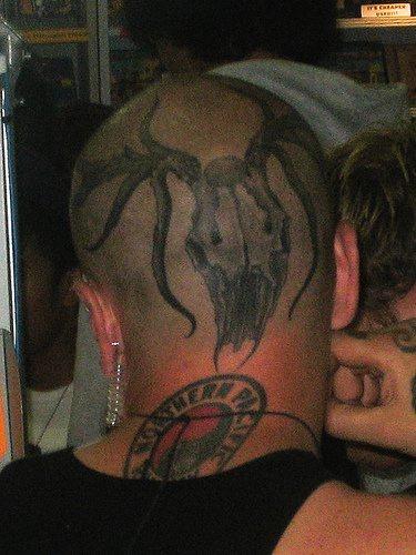 Tattooed head, big, awful spider monster,round  sign