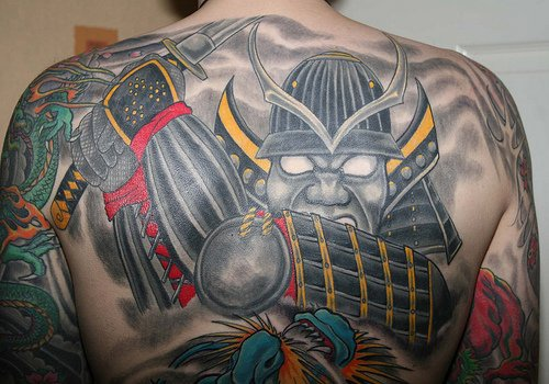 Iron robot tattoo in attack on upper back