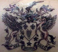 Detailed heraldic shield tattoo