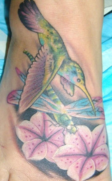 Tattoo of hummingbird and dragonfly