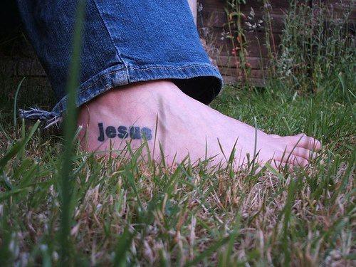 Jesus name tattoo on foot
