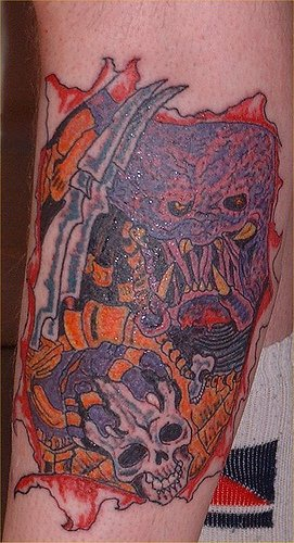 Colourful predator and skull tattoo