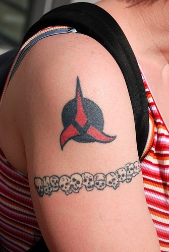 Skulls and red on black symbol tattoo