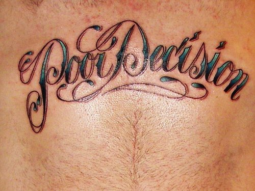 Tattoo on stomach, poor decision,styled  inscription