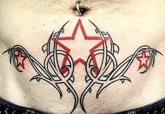 Tattoo on stomach,red stars in the thickets