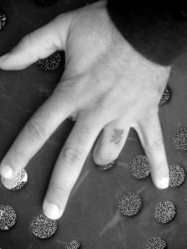 Little black hieroglyph  tattoo on the hand