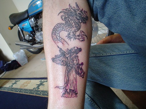 Tattoo on leg, magician and flying monster