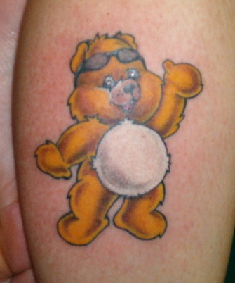 Little yellow bear tattoo