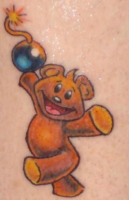 Teddy bear with bomb coloured tattoo