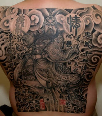 All-powerful samurai on upper back tattoo