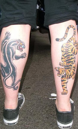Tiger and panther tattoo on legs