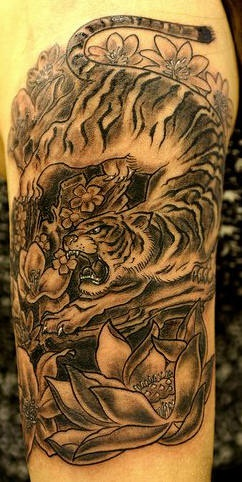 Tiger and flowers black ink tattoo