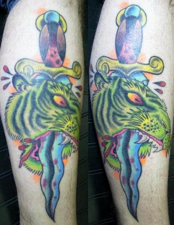 Dead tiger with dagger tattoo