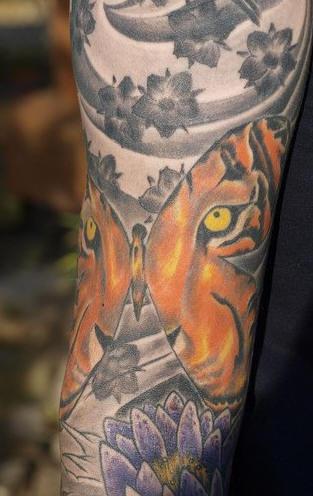 Tiger eye on asian sleeve tattoo