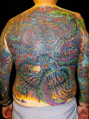 Full back tiger and dragon fight tattoo