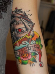 Traditional pirate ship frienship tattoo