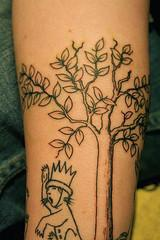 Sketched tree tattoo with funny king
