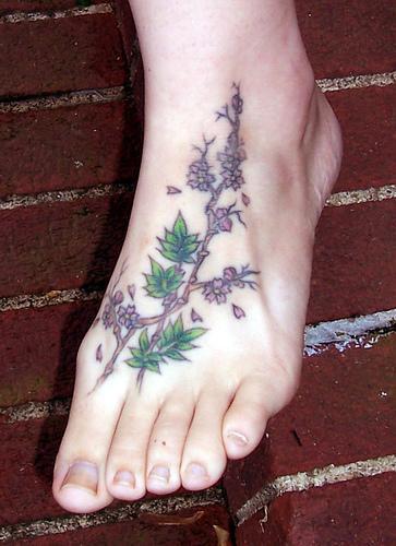 Colored tree tattoo on foot