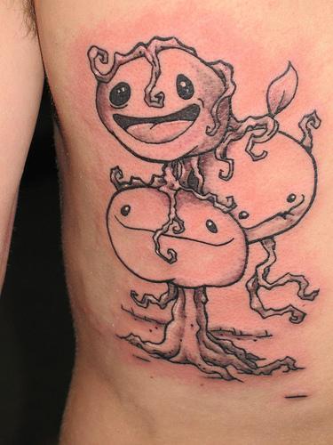 Tree tattoo with three funny faces