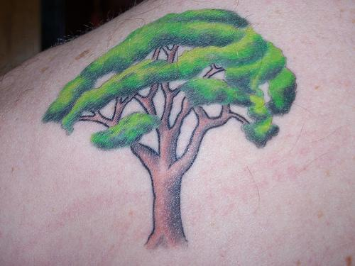 Tree tattoo with nice green leaves