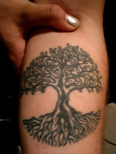 Black tree tattoo with leaves and roots
