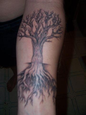 Black tree tattoo with big roots