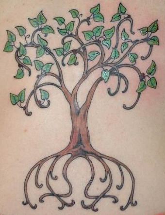 Nice tree tattoo with green leaves