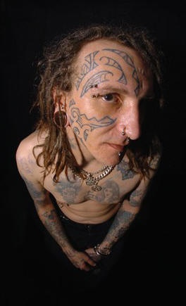 Man with tribal face tattoo