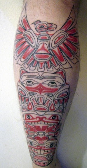 Leg tattoo picture, red tribal styled bird and men