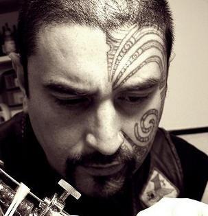 Tribal maori face tattoo