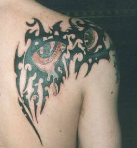 Tribal from shoulder to scapula tattoo with red eyes